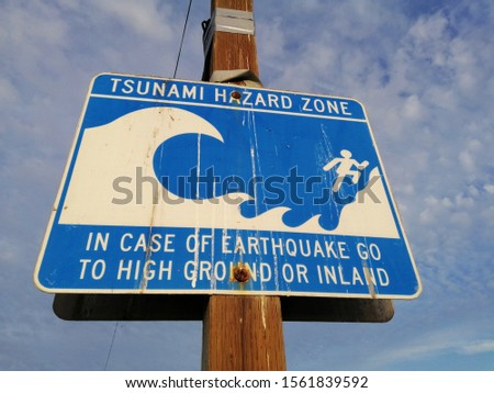 Tsunami Hazard Zone Sign in Marina Del Rey, Venice, California, Blue Sky with Clouds