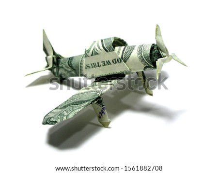 Origami money airplane FIGHTER war  military aircraft one dollar green expensive Isolated on White Background