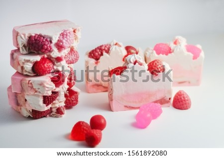 Handmade pink soap.Cold Processed Handcrafted Soap.Home made soap look like cake, ice cream with berries,glitter on gray background with sparkles.Natural homemade cosmetics and handmade soaps concept. #1561892080