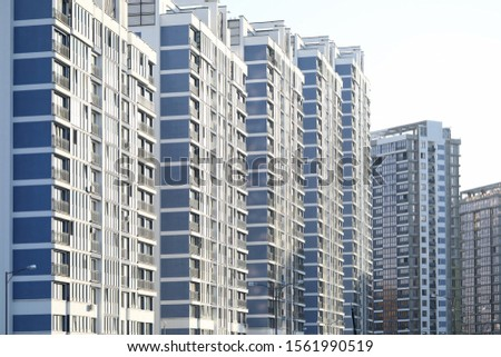 Architecture of city with modern design. Facade of construction for people to live. Exterior of apartments or renovation in town. Structure with lots of floors #1561990519