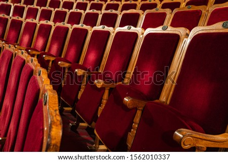 Row of red seats in theatre #1562010337