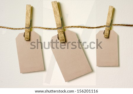 Close up of a note and a clothes peg on white background with clipping path #156201116