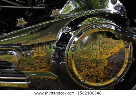 Gleaming reflective chrome surface, motorcycle closeup,ocher coloured reflections #1562106346