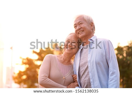 outdoor portrait of loving senior asian couple, happy and smiling #1562138035