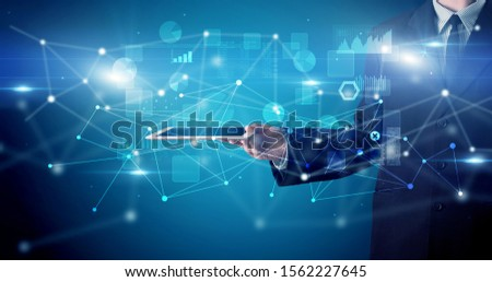 Elegant hand holding tablet with virtual database and network concept #1562227645