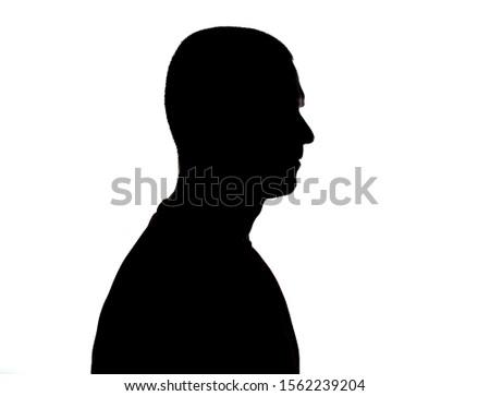 Silhouette of adult man portrait in studio #1562239204