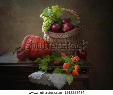 Still life with pumpkin and fruits basket #1562258434