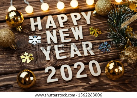 Happy New Year 2020. Symbol from number 2020 on wooden background #1562263006