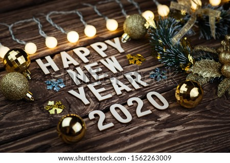 Happy New Year 2020. Symbol from number 2020 on wooden background #1562263009