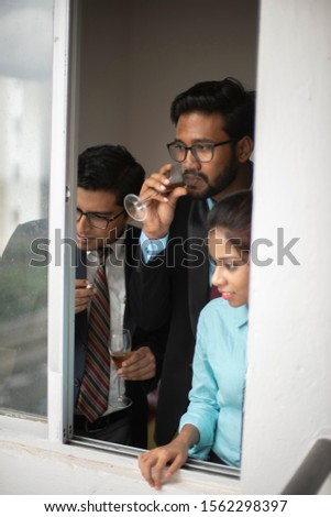 Corporate meetings between  young and energetic Indian Bengali bosses/officers/managers and secretary at window of the office building regarding buying a project land. Indian corporate lifestyle #1562298397