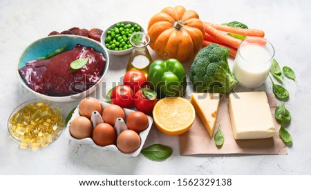 Foods high in vitamin A (Retinol). Protects eyes from blindness;  supports bone health; supports a healthy immune system;  Top view #1562329138