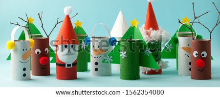 Santa claus, Grinch, Snowman from toilet tube roll for winter holiday decor. A terrible craft. School and kindergarten. Handcraft creative idea for Christmas new year, banner Royalty-Free Stock Photo #1562354080