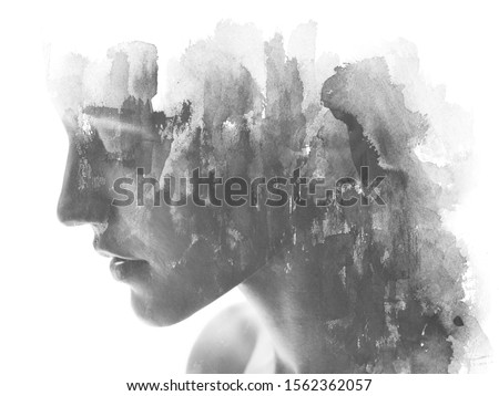 Paintography. Double exposure. Profile portrait photograph blends with hand made black ink painting on white background