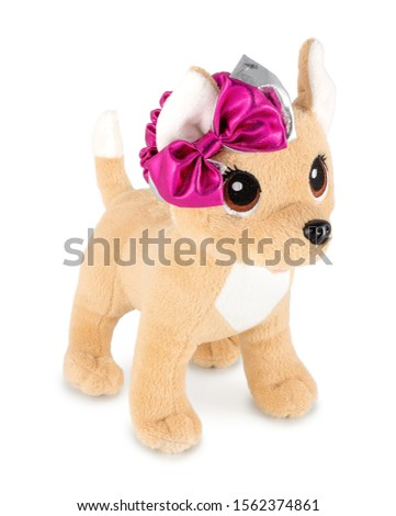 Cute dog doll with pink ribbon isolated on white background with shadow. Playful bright brown dog sitting on white underlay. Puppy plush stuffed puppet toy for children. Plaything for kids. #1562374861