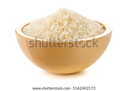 Heap of white uncooked, raw long grain rice in wooden bowl on white background #1562402173
