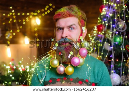 Christmas beard decorations. Winter holidays. New year party. Decorated beard. Bearded man with decorated beard. Christmas decoration. Christmas holidays. Surprised bearded man with decorated beard #1562416207
