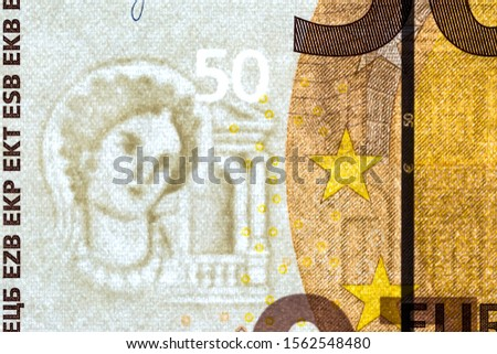 Watermark on a banknote of 50 euros macro close-up. Translucent 50 Euro banknote with visible watermarks.