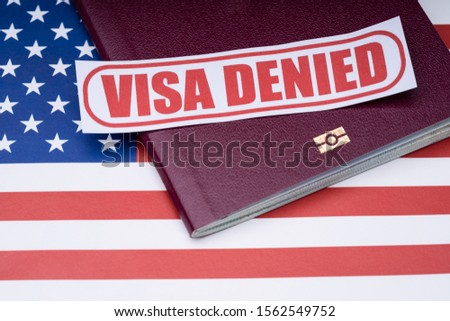 Note Paper With Visa Denied Text And Passport Over American Flag Background #1562549752