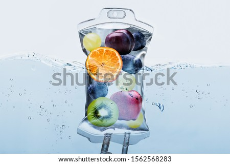 Close-up Of Various Fruit Slices In Saline Bag Dip In Water Against White Background #1562568283