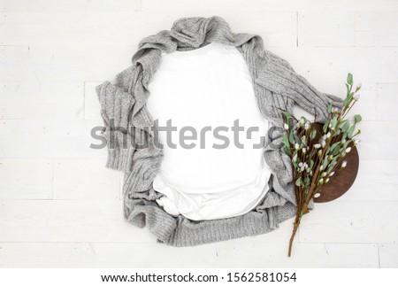 Blank flat lay white women's t-shirt with gray wool cardigan on white wood flooring, women's apparel fall/winter mockup