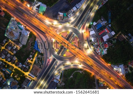 Aerial view of highway junctions Top view of Urban city, Bangkok at night, Thailand. Light trails across road junction, traffic abstract and transportation concept. #1562641681