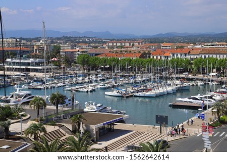 SAINT-RAPHAËL, FRANCE - 05/22/2019: View of Saint Raphael port from the famous Ferris wheel on a sunny spring day. #1562642614