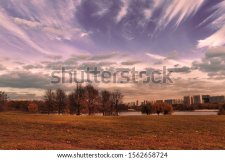 Autumn city in the distance #1562658724