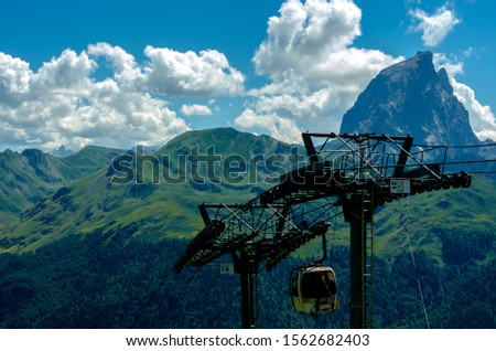 Beautifully dramatic scenery of a cable car passing near the Pic du Midi mountain in the Pyrenees, France