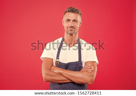 Homemade is best. Cook with bristle crossed arms on chest red background. Cook food at home. Man mature cook posing cooking apron. Fine recipe. Ideas and tips. Chief cook and professional culinary. #1562728411