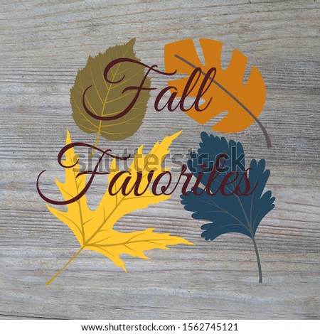Warm and cozy fall leaves Fall Favorites on a wood textured background. Fall colors, pretty advertisement for seasons changing.