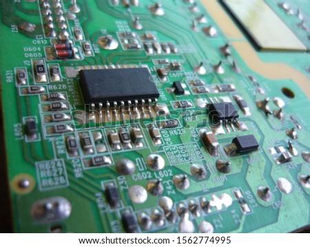 Closeup on electronic board in hardware repair shop #1562774995