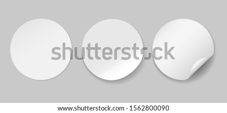 Circle adhesive symbols. White tags, paper round stickers with peeling corner, isolated rounded plastic mockup signs, vector illustration #1562800090