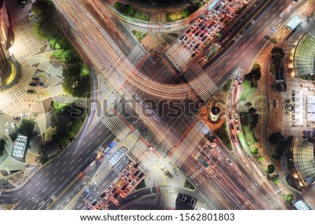 Night aerial view of road intersection at downtown of Seoul in South Korea. Cars and colorful buses on streets in evening. Night city traffic. Seoul is a popular tourist destination of Asia. #1562801803