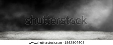 Empty space of Studio dark room with white fog and concrete floor for interior decoration. #1562804605