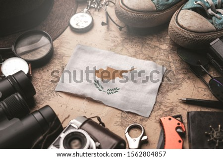 Cyprus Flag Between Traveler's Accessories on Old Vintage Map. Tourist Destination Concept.  #1562804857