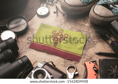 Chuvashia Flag Between Traveler's Accessories on Old Vintage Map. Tourist Destination Concept.  #1562804908