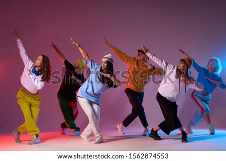 Modern dancers posing in front of studio background, performing modern dance element, professional group of dancers preparing for concert, practicing movies #1562874553
