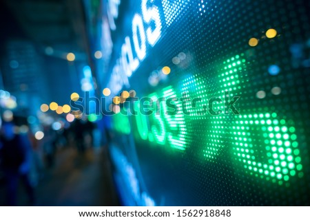 Display stock market numbers with defocused street lights background Royalty-Free Stock Photo #1562918848