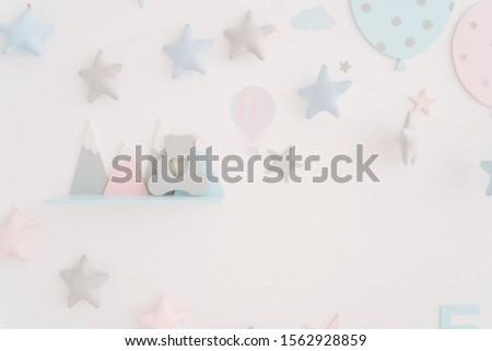 Children Playroom Star Ornament Wall Decoration. Contemporary Kid Room Colorful Balloons Imitation Decor. Toddler Toys Shelf Modern Indoor Interior Design Preschooler Plaything Concept #1562928859