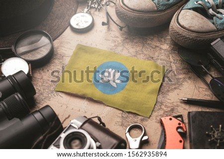 Kalmykia Flag Between Traveler's Accessories on Old Vintage Map. Tourist Destination Concept. #1562935894