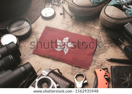 Hong Kong Flag Between Traveler's Accessories on Old Vintage Map. Tourist Destination Concept. #1562935948
