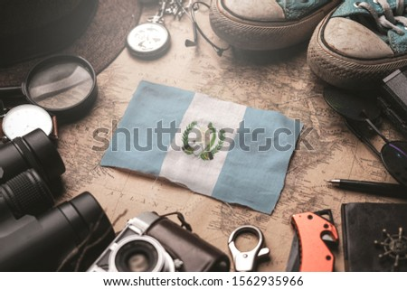 Guatemala Flag Between Traveler's Accessories on Old Vintage Map. Tourist Destination Concept. #1562935966