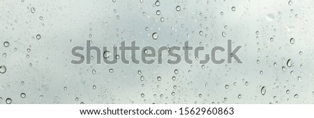 rain drops background and raining rain blue rain background. #1562960863