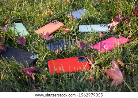 Different Color Phone Case on the Grass #1562979055