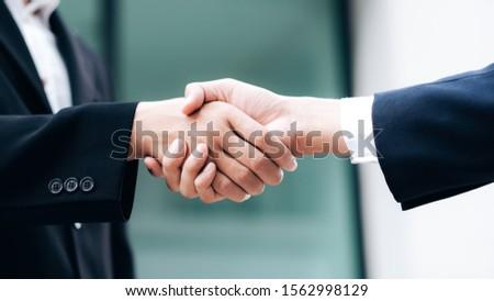 Businessmans handshake. Successful businessmen handshaking after good deal. Business partnership meeting concept. #1562998129