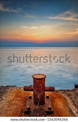 A corroded bollard on the abandoned jetty #1563046366