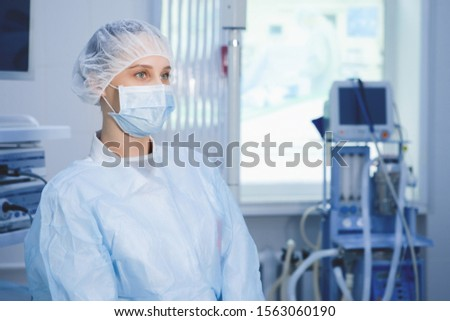 Surgical nurse prepares instruments for surgery in the operating room. #1563060190