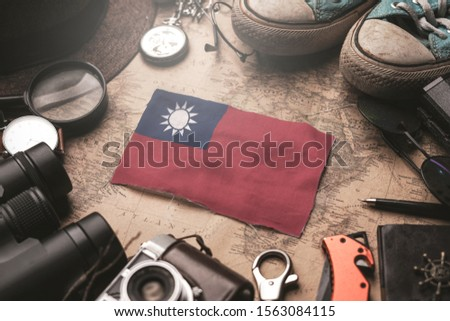 Taiwan Flag Between Traveler's Accessories on Old Vintage Map. Tourist Destination Concept.                    #1563084115