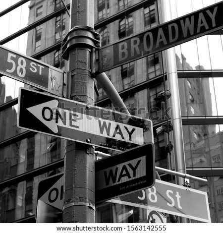 Crowded street sign in Manhattan, New York City, including 58th street and Broadway.