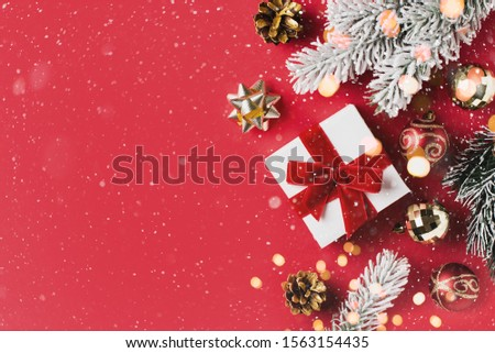 Christmas and new year rad and golden celebration flat lay with gift, ball and cone, copy space, top view #1563154435